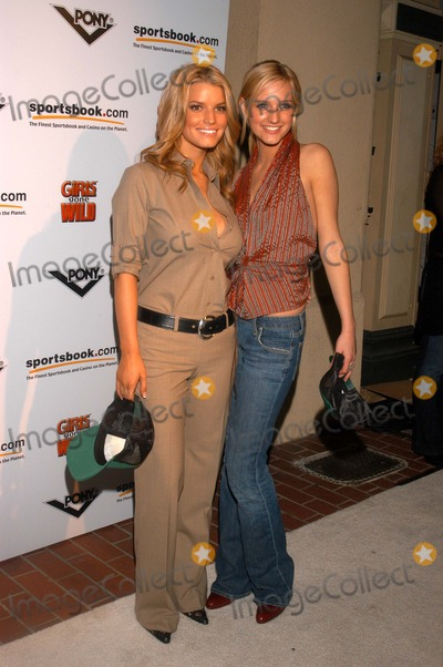 "Jessica Simpson, Ashely Simpson, ASH, Jessica Paré Photo - Jessica Simpson and sister Ashely Simpson at the pre-Super Bowl party thrown by ""Pony,"" ""Girls Gone Wild"" and ""Sportsbook.com,"" Market Street, San Diego, CA 01-24-03"
