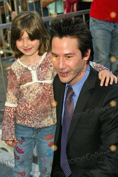 Keanu Reeves Photo - Keanu Reeves and fan at Reeves induction in the Hollywood Walk of Fame, Hollywood, CA, 01-31-05