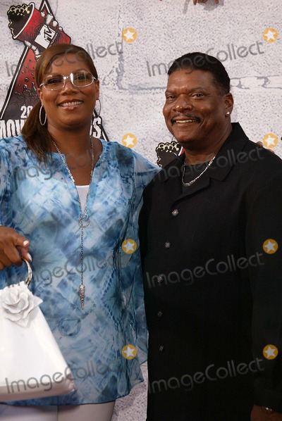 Queen Latifah, Latifah, Queen, Father Alberto Cutié Photo - Queen Latifah and her father at the 2004 MTV Movie Awards, Sony Studios, Culver City, CA 06-05-04
