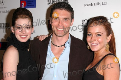 Anne Hathaway, Anson Mount, Lindsay Lohan, Ann Hathaway Photo - Anne Hathaway, Anson Mount and Lindsay Lohan at the Defense For Children International Fundraiser at the Beverly Hills Mercedes Benz Showroom, Beverly Hills, CA. 05-12-04