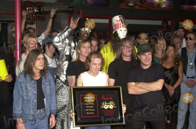 Cliff Williams, Brian Johnson, Angus Young, Malcolm Young, The Ceremonies Photo -  Cliff Williams, Brian Johnson, Angus Young, Malcolm Young at the ceremony where they were inducted into Sunset Blvd's Rockwalk. 09-15-00
