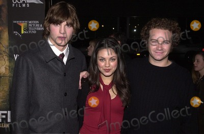 "Ashton Kutcher, Danny Masterson, Mila Kunis Photo -  Ashton Kutcher  Mila Kunis   Danny Masterson at the premiere of USA Films ""Traffic"" in Beverly Hills, 12-14-00"