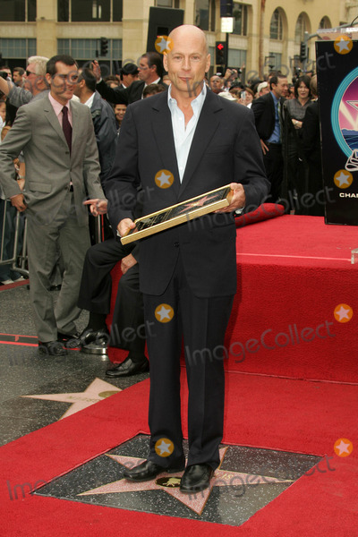 Bruce Willis, The Ceremonies Photo - Bruce Willisat the Ceremony honoring him with the 2,321st star on the Hollywood Walk of Fame. Hollywood Boulevard, Hollywood, CA. 10-16-06
