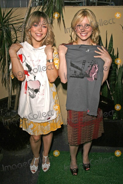 """Ashley Peldon, Courtney Peldon Photo - Ashley Peldon and Courtney Peldon holding shirts by Roger Claude Clothing  at the Launch party for """"Starring...!"""" Fragrances and """"Charmed"""" Jewelry, benefitting Tree People. Whole Foods Lifestyle Store, Los Angeles, CA. 04-21-08"""