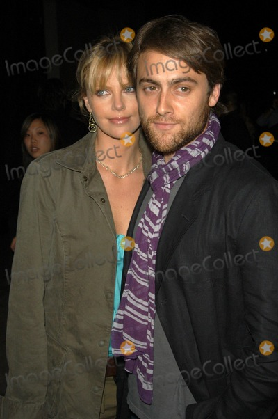 Charlize Theron, Stuart Townsend Photo - Charlize Theron and boyfriend Stuart Townsend at the Flaunt Magazine Summer Reign Party, Falcon, Hollywood, CA 06-20-03