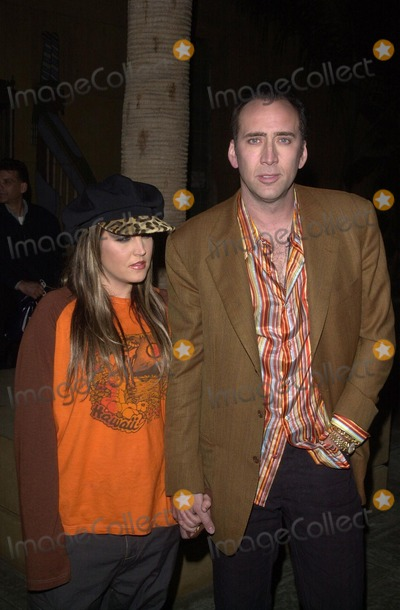 "Lisa Marie, Lisa Marie Presley, Nicolas Cage, Lisa Maris Photo - Nicolas Cage and Lisa Marie Presley at the American Cinematheque's tribute to Nicolas Cage, featuring a screening of his new film ""Adaptation"" at the Egyptian Theater, Hollywood, CA 11-23-02"
