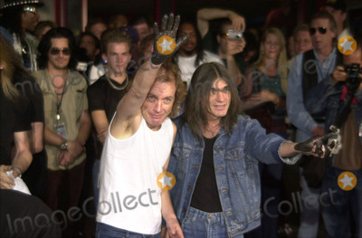 Angus Young, Malcolm Young, The Ceremonies Photo -  Angus Young, Malcolm Young at the ceremony where they were inducted into Sunset Blvd's Rockwalk. 09-15-00