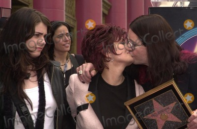 Aimee Osbourne, Kiss, Anouk Aimé Photo - Aimee Osbourne looks on as Mom Sharon and Dad Ozzy kiss at Ozzy's star on the Walk of Fame ceremony in front of Ripley's Believe It Or Not museum on Hollywood Blvd, 04-12-02