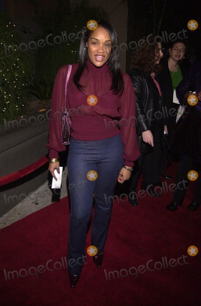 "Arnelle Simpson, The Grinch Photo -  Arnelle Simpson at the ""Geneva Vs. The Grinch"" holiday celebration, by Geneva Films, Reign Nightclub, 12-18-00"