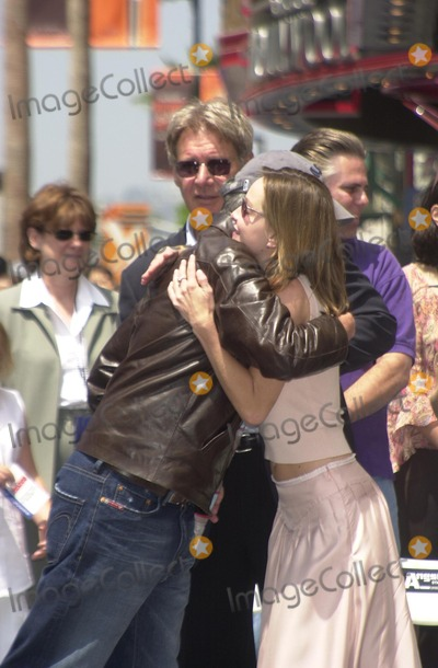 Steven Spielberg, Harrison Ford, Calista Flockhart Photo - Steven Spielberg, Harrison Ford and Calista Flockhart at Ford's induction ceremony into the Hollywood Walk of Fame, Hollywood, CA 05-30-03