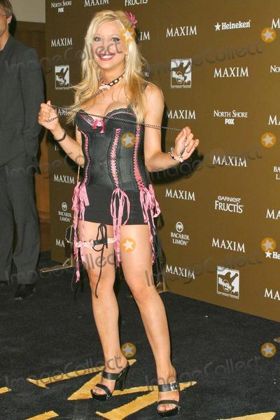 Courtney Peldon Photo - Courtney Peldon at the Maxim Hot 100 Party at the Hard Rock Hotel & Casino, Las Vegas, Nevada 06-12-04