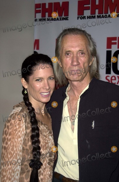 "Annie Bierman, David Carradine Photo - Annie Bierman and David Carradine at FHM Magazines ""Sexiest Party of the Year"" to celebrate it's annual 100 Sexiest Women in the World issue, Raleigh Studios, Hollywood, CA 06-05-03"