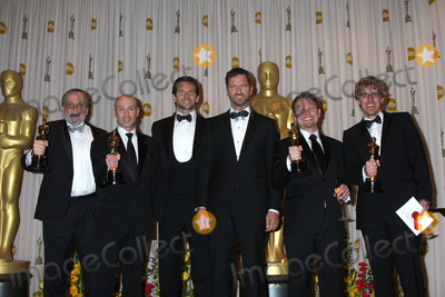 Bradley Cooper, Gerard Butler, Andrew Jones, Joe Letteri, Stephen Rosenbaum Photo - Presenters Bradley Cooper and Gerard Butler (both center) pose with (L-R) Joe Letteri, Stephen Rosenbaum, Richard Baneham and Andrew Jones, winners of Best Visual Effects for 'Avatar