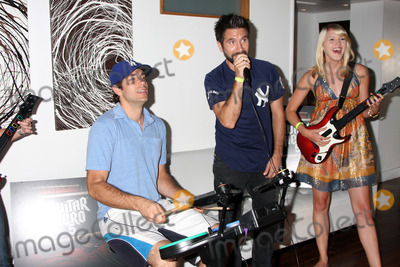 Gomez, Joshua Gomez, Zach Levi, Ashley Campbell Photo - Zach Levi, Joshua Gomez, Ashley CampbellChuck Kickoff party presented by Guitar Hero FiveRoosevelt Hotel Pool Los Angeles,  CAOctober 10,  2009