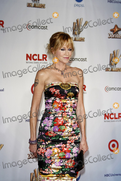 Melanie Griffith, Melanie Griffiths Photo - LOS ANGELES - SEP 10:  Melanie Griffith arriving at the 2011 NCLR ALMA Awards held at Santa Monica Civic Auditorium on September 10, 2011 in Santa Monica, CA