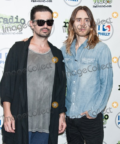 Jared Leto, Thirty Seconds to Mars, Tomo Milicevic Photo - BALA CYNWYD, PA - SEPTEMBER 29: (L to R) Tomo Milicevic and Jared Leto of American Alternative Rock Band Thirty Seconds To Mars Pose at Radio 104.5's Performance Theatre on September 29, 2013 in Bala Cynwyd, Pennsylvania. (Photo by Paul J. Froggatt/FamousPix)