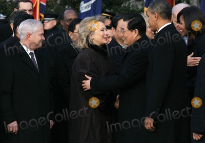 Barack Obama, First Lady Michelle Obama, Hillary Clinton, Hu Jintao, Mark Wilson, Michelle Obama, President Barack Obama, President Hu, President Hu Jintao, Robert gates, White House, The White Photo - WASHINGTON, DC - JANUARY 19: (AFP OUT) Chinese President Hu Jintao (C), escorted by U.S. President Barack Obama (2nd R), reaches to embrace U.S. Secretary of State Hillary Clinton during a State arrival ceremony on the South Lawn of the White House January 19, 2011 in Washington, DC. Obama and Hu are scheduled to meet in the Oval Office later in the day, hold a joint press conference and attend a State dinner. Also pictured (L-R) are U.S. Defense Secretary Robert Gates and U.S. first lady Michelle Obama.  