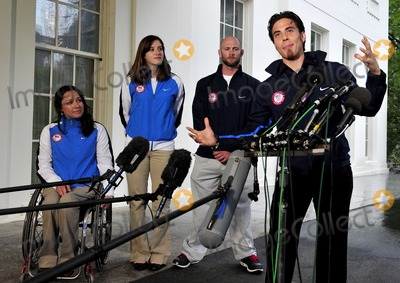 Apolo Anton Ohno, Barack Obama, President Barack Obama, First Lady Michelle Obama, Michelle Obama, Alana Nichols, Apolo Ono, White House, The White Photo - Apolo Anton Ohno, Olympic Short Track Speed Skater, makes remarks to reporters after meeting United States President Barack Obama and first lady Michele Obama at the White House in Washington, D.C. on Wednesday, April 21, 2010.  From left to right: Alana Nichols, Paralympic Sit Skiier; Katherine Reutter, Olympic Speed Skater; Heath Calhoun, Paralympic Sit Skiier; and Apolo Ono.