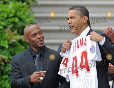 Barack Obama, Jimmy Rollins, President Barack Obama, White House, The White Photo - Washington, D.C. - May 15, 2009 -- United States President Barack Obama shows off the jersey presented to him by shortstop Jimmy Rollins, left as he welcomes the 2008 Baseball World Champion Philadelphia Phillies to the White HouseDigital Photo by Ron Sachs/POOL-CNP-PHOTOlink.net