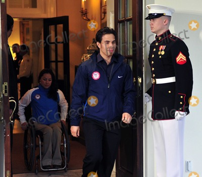 Apolo Anton Ohno, Barack Obama, President Barack Obama, First Lady Michelle Obama, Michelle Obama, Alana Nichols, White House, The White Photo - Apolo Anton Ohno, Olympic Short Track Speed Skater, center, leads Alana Nichols, Paralympic Sit Skiier, left, out of the West Wing of the White House after their meeting with United States President Barack Obama and first lady Michele Obama in Washington, D.C. on Wednesday, April 21, 2010Photo by Ron Sachs/Pool-CNP-PHOTOlink.net