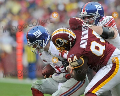 Anthony Montgomery, Eli Manning Photo - RESTRICTED: NO NEW YORK OR NEW JERSEY NEWSPAPERS WITHIN A 75 MILE RADIUS OF NYC.