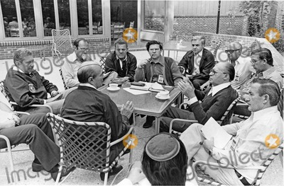 Jimmy Carter, President Jimmy Carter, Foreigner, The Unit, White House Photo - Prime Minister Menachem Begin of Israel, briefs members of the Israeli delegation on the porch of Laurel Lodge at Camp David, the United States presidential retreat near Thurmont, Maryland to discuss the summit with President Anwar Sadat of Egypt (not pictured) and U.S. President Jimmy Carter (not pictured) on September 2, 1978.  visible in the photo are Foreign Minister Moshe Dayan of Israel, bottom left center, and Defense Minister Ezer Weizman, left.Photo by White House /CNP-PHOTOlink.net
