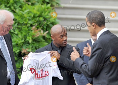 Barack Obama, Jimmy Rollins, President Barack Obama, White House, The White Photo - Washington, D.C. - May 15, 2009 -- United States President Barack Obama, right, looks at the jersey presented to him by shortstop Jimmy Rollins, center, as he welcomes the 2008 Baseball World Champion Philadelphia Phillies to the White House.  Phillies manager Charlie Manuel looks on from left.Digital Photo by Ron Sachs/POOL-CNP-PHOTOlink.net