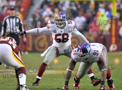 Antonio Pierce, Justin Tuck, Rush Photo - RESTRICTED: NO NEW YORK OR NEW JERSEY NEWSPAPERS WITHIN A 75 MILE RADIUS OF NYC.