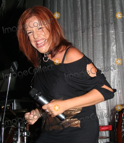 Albita Photo - Miami Beach, FL  08-21-2007Two time Grammy winner Albita, in concert at Score Nightclub in Miami Beach.Digital Photo by JR Davis-PHOTOlink.net