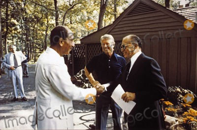 Jimmy Carter, President Jimmy Carter, The Used, White House Photo - President Anwar al-Sadat of Egypt, left, shakes hands with Prime Minister Menachem Begin of Israel, right, as United States President Jimmy Carter, center, looks on 06 September 1978 at Camp David, the US presidential retreat near Thurmont, Maryland prior to their meeting on September 6, 1978.Photo by Karl Schumacher / White House /CNP-PHOTOlink.net