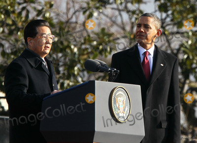 Barack Obama, Hu Jintao, President Barack Obama, President Hu, President Hu Jintao, President Obama, Alex Wong, White House, The White Photo - WASHINGTON, DC - JANUARY 19: (AFP OUT) Chinese President Hu Jintao (L) speaks as U.S. President Barack Obama (R) looks on during a state arrival ceremony at the South Lawn of the White House January 19, 2011 in Washington, DC. Hu and President Obama will hold a press conference at the White House later today.Photo by  Alex Wong/Pool/CNP-PHOTOlink.net