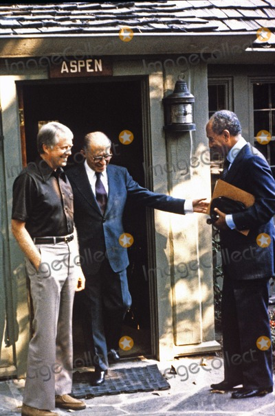 Jimmy Carter, President Jimmy Carter, The Used, White House Photo - President Anwar al-Sadat of Egypt, right, and Prime Minister Menachem Begin of Israel, center, and United States President Jimmy Carter emerge from Aspen Lodge at Camp David, the US presidential retreat near Thurmont, Maryland following a meeting during their summit to discuss a peace treaty between Egypt and Israel in September, 1978.Photo by White House /CNP-PHOTOlink.net