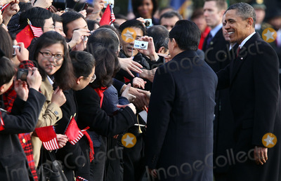 Barack Obama, Hu Jintao, President Barack Obama, President Hu, President Hu Jintao, President Obama, Alex Wong, White House, The White Photo - WASHINGTON, DC - JANUARY 19: (AFP OUT)  Chinese President Hu Jintao (2nd R) is greeted by guests as U.S. President Barack Obama (R) looks on during a state arrival ceremony at the South Lawn of the White House January 19, 2011 in Washington, DC. Hu and President Obama will hold a press conference at the White House later today.  