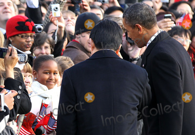 Barack Obama, Hu Jintao, President Barack Obama, President Hu, President Hu Jintao, President Obama, Sasha, Sasha Obama, SASHA OBAMA,, Alex Wong, White House, The White Photo - WASHINGTON, DC - JANUARY 19: (AFP OUT) Sasha Obama (L), the younger daughter of U.S. President Barack Obama (R), greets Chinese President Hu Jintao (C) during a state arrival ceremony at the South Lawn of the White House January 19, 2011 in Washington, DC. Hu and President Obama will hold a press conference at the White House later today.Photo by  Alex Wong/Pool/CNP-PHOTOlink.net