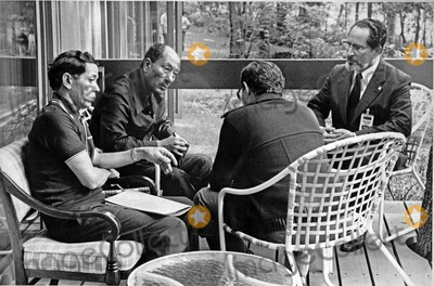 Kamal, Foreigner, White House Photo - President Anwar Sadat of Egypt, center left, confers with Foreign Minister Muhammad Ibrahim Kamal of Egypt, right, Deputy Premier Hassan Tohami of Egypt, right center, and Osama Al Baz, Ambassador of Egypt to the U.S., left, at Camp David, near Thurmont, Maryland on Tuesday, September 12, 1978.Photo by White House /CNP-PHOTOlink.net