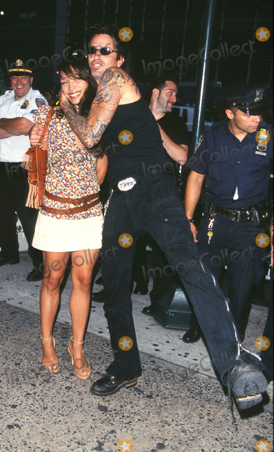 """Tommy Lee Photo - Photo by: Peter KramerSTAR MAX, Inc. - copyright 2001. 8/1/01Tommy Lee with date at """"MTV20: Live and Almost Legal"""".(Hamerstein Ballroom, NYC)"""