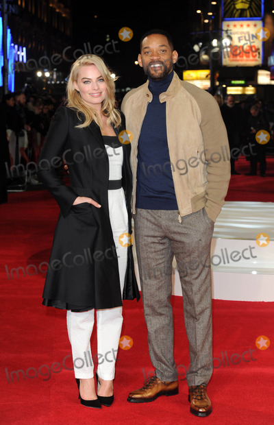 """Will Smith, Margot Robbie Photo - Photo by: KGC-03/starmaxinc.comSTAR MAX2015ALL RIGHTS RESERVEDTelephone/Fax: (212) 995-11962/11/15Margot Robbie and Will Smith at a special screening of """"Focus"""".(London, England, UK)"""