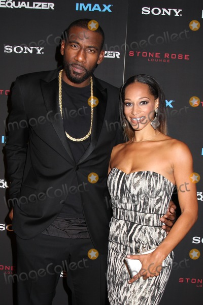 """Amar'e Stoudemire, Amare Stoudemire Photo - Photo by: HQB/starmaxinc.comSTAR MAX2014ALL RIGHTS RESERVEDTelephone/Fax: (212) 995-11969/22/14Amar'e Stoudemire and Alexis Stoudemire at the premiere of """"The Equalizer"""".(NYC)"""