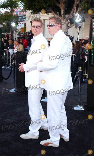 "Adrian Rayment, Neil Rayment Photo - Photo by: Lee Roth STAR MAX, Inc. - copyright 2003 ALL RIGHTS RESERVED Telephone/Fax: (212) 995-1196 5/7/03 Adrian Rayment and Neil Rayment  at the Los Angeles premiere of ""Matrix Reloaded"". (Westwood, CA)"