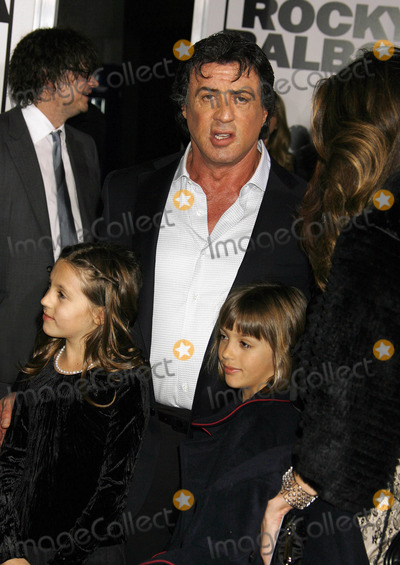 """Sylvester Stallone Photo - Photo by: NPX/starmaxinc.com2006. 12/13/06Sylvester Stallone and his daughters at the premiere of """"Rocky Balboa"""".(Hollywood, CA)***Not for syndication in France!***"""