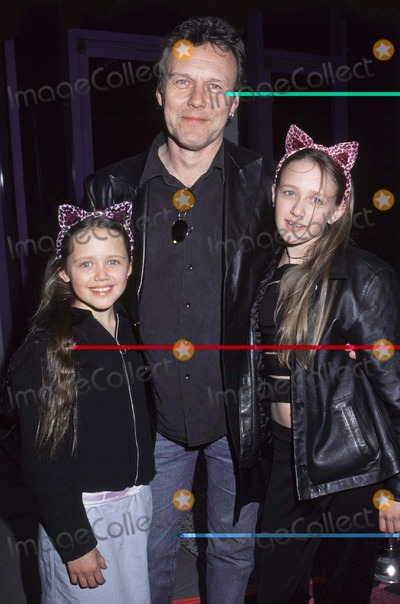 Anthony Stewart Head, Slayer, Buffie Photo - Photo By Russ Einhorn 4_9_01Copyright Star Max 2001_Josie and the Pussycats_PremiereThe Galaxy TheaterHollywood_CaliforniaAnthony Stewart Head from Buffy the Vampire Slayer with his two daughters as they arrive to see the Premiere