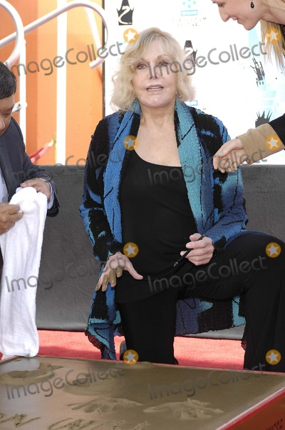 Kim Novak, Grauman's Chinese Theatre Photo - Kim Novak during a ceremony honoring her with Handprints and Footprints immortalized in cement, at Grauman's Chinese Theatre, April 14, 2012, in Los Angeles.Photo: Michael Germana Star Max