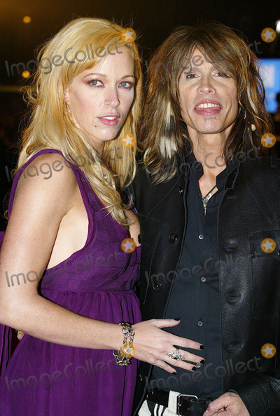 Steven Tyler Photo - Steven Tyler and guest at the Brit Awards. (London, England) 2/14/07