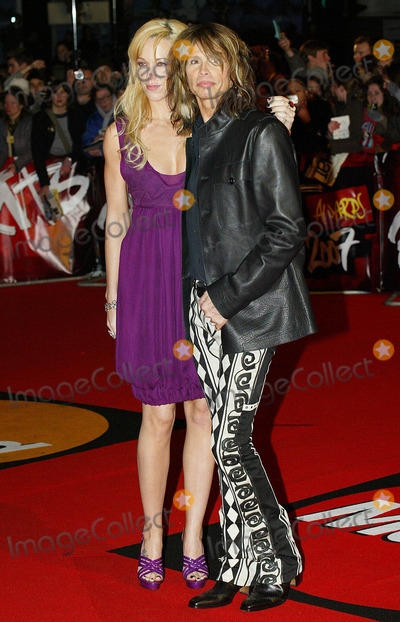 Steven Tyler Photo - Steven Tyler and guest at the Brit Awards.