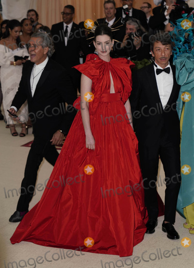 """Anne Hathaway, Ann Hathaway, Pierpaolo Piccioli Photo - Photo by: zz/XPX/starmaxinc.comSTAR MAXCopyright 2018ALL RIGHTS RESERVEDTelephone/Fax: (212) 995-11965/7/18Anne Hathaway and Pierpaolo Piccioli at the 2018 Costume Institute Benefit Gala celebrating the opening of """"Heavenly Bodies: Fashion and the Catholic Imagination"""".(The Metropolitan Museum of Art, NYC)"""