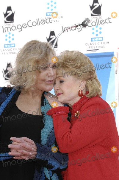 Debbie Reynolds, Kim Novak, Grauman's Chinese Theatre Photo - Kim Novak and Debbie Reynolds during a ceremony honoring Kim Novak with her Handprints and Footprints immortalized in cement, at Grauman's Chinese Theatre, April 14, 2012, in Los Angeles.Photo: Michael Germana Star Max