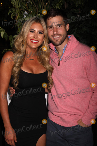 Photo - Photo by: Victor Malafronte/starmaxinc.comSTAR MAX2017ALL RIGHTS RESERVEDTelephone/Fax: (212) 995-119610/12/17Juelia Kinney and JJ Lane at The WE TV celebration of the return of Marriage Bootcamp Reality Stars atThe Attic Rooftop & Lounge in New York City.