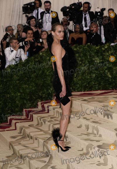 """Amber Valletta Photo - Photo by: zz/XPX/starmaxinc.comSTAR MAXCopyright 2018ALL RIGHTS RESERVEDTelephone/Fax: (212) 995-11965/7/18Amber Valletta at the 2018 Costume Institute Benefit Gala celebrating the opening of """"Heavenly Bodies: Fashion and the Catholic Imagination"""".(The Metropolitan Museum of Art, NYC)"""