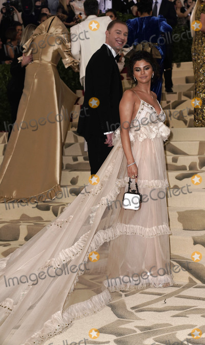 """Gomez, Selena Gomez, Stuart Vevers Photo - Photo by: XPX/starmaxinc.comSTAR MAXCopyright 2018ALL RIGHTS RESERVEDTelephone/Fax: (212) 995-11965/7/18Selena Gomez and Stuart Vevers at the 2018 Costume Institute Benefit Gala celebrating the opening of """"Heavenly Bodies: Fashion and the Catholic Imagination"""".(The Metropolitan Museum of Art, NYC)"""