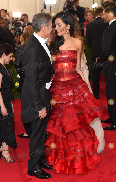 """George Clooney, Amal Clooney Photo - Photo by: KGC-146/starmaxinc.comSTAR MAX2015ALL RIGHTS RESERVEDTelephone/Fax: (212) 995-11965/4/15George Clooney and Amal Clooney at the 2015 Costume Institute Benefit Gala - """"China: Through The Looking Glass"""".(Metropolitan Museum of Art, NYC)"""